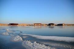 Красочные лачуги на замороженном озере Стоковые Фото