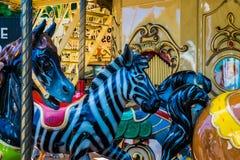 Красочные веселые идут лошади круга стоковые фото
