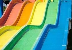 Красочные водные горки на aquapark Стоковое Изображение