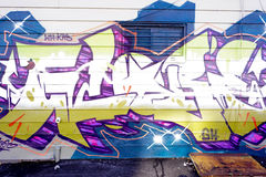 Красочные граффити на кирпичной стене Стоковые Фотографии RF