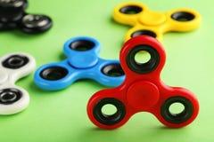 Красочные игрушки обтекателя втулки непоседы стоковые фотографии rf