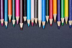 Красочные карандаши на черной предпосылке Стоковое Фото