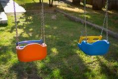 Красочные качания для детей стоковое фото rf