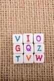 Красочные кубы письма алфавита на холсте Стоковая Фотография RF