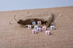 Красочные кубы письма алфавита из мешка Стоковое Изображение RF