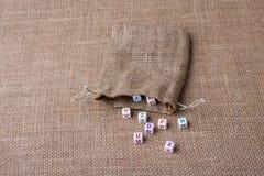 Красочные кубы письма алфавита из мешка Стоковое Фото