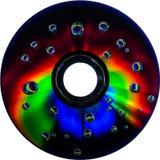 Красочные падения воды на диске КОМПАКТНОГО ДИСКА DVD Стоковое фото RF