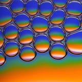 Красочные пузыри мыла в воде стоковое фото rf