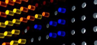 Красочные пункты света на темной предпосылке стоковые изображения