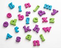 Красочные пластичные письма алфавита на белой предпосылке Стоковое фото RF
