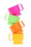 Красочные пластичные чашки Стоковое фото RF