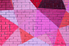Красочные розовое, фиолетовый, коралл и бургундская покрашенная кирпичная стена Стоковая Фотография