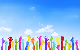 Красочные руки поднятые с голубым небом Стоковое фото RF