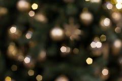 Красочные света на красной предпосылке Bokeh праздника абстрактное рождество Стоковые Изображения RF