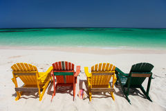Красочные стулья на карибском пляже Стоковая Фотография RF