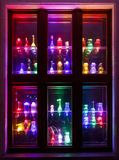 Красочные украшения бутылки на окне Стоковая Фотография