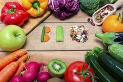Красочные фрукты и овощи на предпосылке с словом био Стоковые Фото