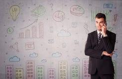 Красочные чертежи на стене с бизнесменом Стоковые Фото