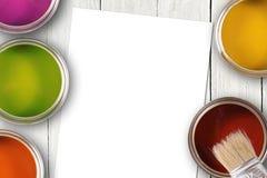 Красочные чонсервные банкы краски и пустой лист белой бумаги стоковое изображение rf