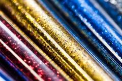Красочные яркие блески в пластиковой упаковке, Стоковое фото RF