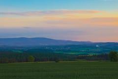 Красочные cluouds над горами Стоковые Фото