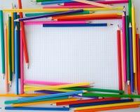 Красочные crayons на проверенной бумаге Стоковое фото RF
