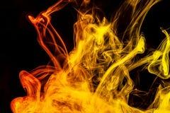 Красочный дым на черной изолированной предпосылке стоковая фотография