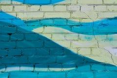 Красочный желтый цвет и покрашенная бирюзой кирпичная стена Стоковое Фото