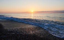 Красочный заход солнца над морем от вступать в противоречия развевает рай природы элемента конструкции состава Стоковая Фотография