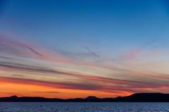 Красочный заход солнца на озере Balaton в лете Стоковые Изображения RF