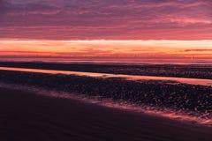Красочный заход солнца над пляжем Formby Стоковая Фотография RF