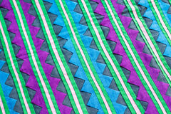 Красочный конец поверхности половика стиля Таиланда вверх по винтажной ткани сделан рук-сплетенной хлопко-бумажной ткани больше и Стоковое Изображение RF