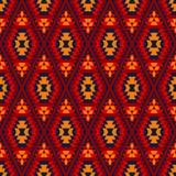 Красочный красный желтый голубой ацтекский диамант орнаментирует геометрическую этническую безшовную картину, вектор бесплатная иллюстрация