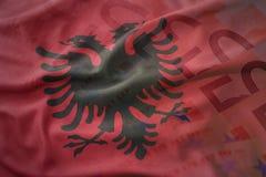 Красочный развевая национальный флаг дальше предпосылки банкнот денег евро Стоковое Изображение RF