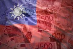 Красочный развевая флаг Тайваня на предпосылке евро Стоковое Изображение RF