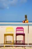 Красочный стул на пляже стоковые фотографии rf