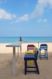 Красочный стул на пляже стоковое фото rf