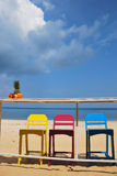 Красочный стул на пляже стоковые фото