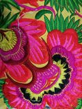 красочный цветок на ткани Стоковые Фотографии RF