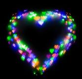 Красочный яркий блеск сформировал сердце, bokeh в форме сердца Стоковые Фото