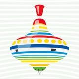 Красочный whirligig игрушки на чувствительной striped предпосылке Стоковые Фото
