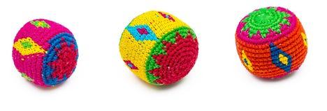 3 красочных жонглируя шарика на белизне стоковые фото