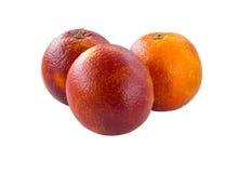 3 красочных красных сицилийских апельсина изолированного на белизне Стоковые Изображения RF