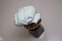 Крем для бритья на щетке Стоковая Фотография