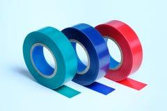 3 крена пестротканой ленты изоляции На голубой предпосылке bluets Зеленый Красный стоковое изображение