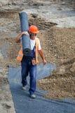 Крены нося работника изоляции geotextile Стоковая Фотография