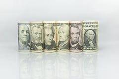 Крен банкноты доллара показал президента объединенного Америки на каждой банкноте Стоковое Изображение