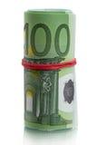 Крен банкнот евро с красной резиной Стоковые Изображения