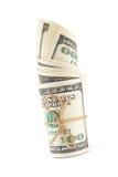 Крен банкнот доллара на белой предпосылке Стоковая Фотография