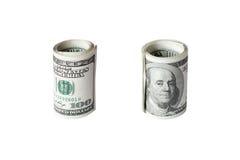 Крен долларов изолированных на белой предпосылке Стоковые Фото